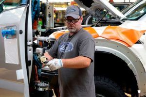 Ford Fallout: How Trump's Tariffs Are Driving Lower Pay, Layoffs at Automaker