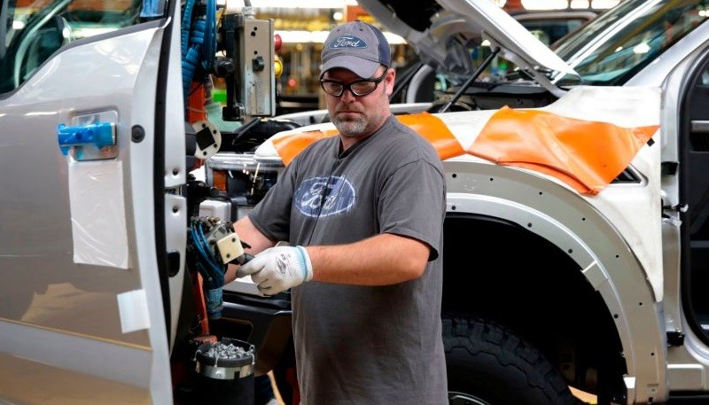 An employee works on the assembly line for Ford.
