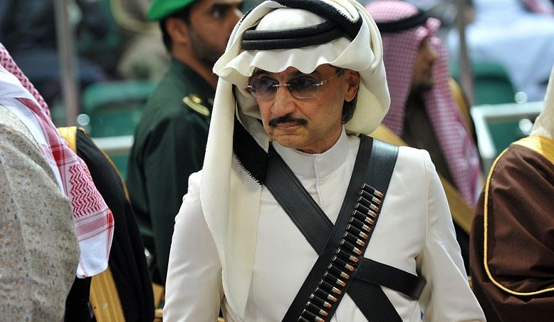 Saudi billionaire owner of Kingdom Holding Company, Prince al-Waleed bin Talal attends the traditional Saudi dancing best known as 'Arda' performed during Janadriya culture festival at Der'iya in Riyadh, on February 18, 2014. Charles arrived in Saudi Arabia on a private visit.