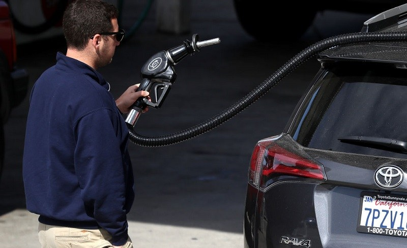 SAN ANSELMO, CA - MAY 10: A customer prepares to pump gasoline into his car at a gas station on May 10, 2017 in San Anselmo, California. California Gov. Jerry Brown is set to announce his revised State budget proposal on Thursday after State senators approved a proposal to increase gas taxes and vehicle fees by $5.2 billion per year to help pay for much needed repairs of CaliforniaÕs aging roads, highways and bridges.