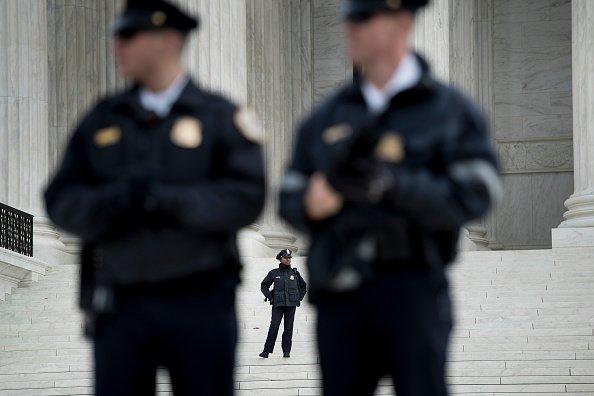 Police guard the Supreme Court