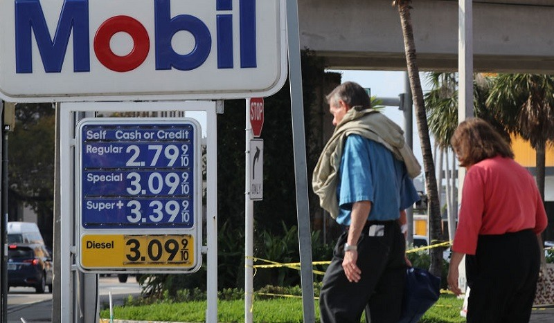 MIAMI, FL - APRIL 09: A sign displaying the price of gasoline per gallon is seen at a Mobil gas station as reports indicate that the price of gas continues to rise on April 9, 2018 in Miami, Florida. AAA forecasts the national gas price average will be as much as $2.70/gallon this spring and summer.