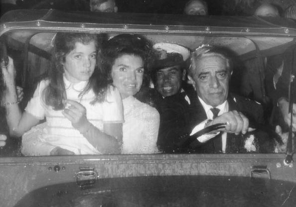 Greek shipping magnate Aristotle Onassis in a car with his new wife Jacqueline Onassis and her daughter Caroline, circa 1968