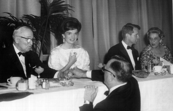 First Lady Jackie Kennedy sits with former president Harry S. Truman and Robert F. Kennedy during a ceremony at the White House January 20, 1962 in Washington, DC.