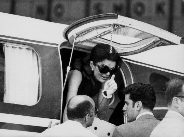 Jacqueline Onassis, formerly Kennedy, leaving an airplane to greet her children in Athens, July 3rd 1969