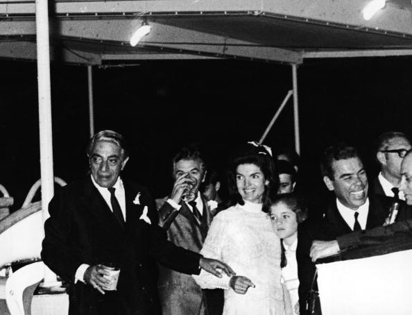 Jaqueline Kennedy Onassis embracing her daughter, Caroline Kennedy, and her new husband, Greek shipping magnate Aristotle Onassis (1906 - 1975), hold a reception aboard the yacht, Christina, shortly after their wedding ceremony on the Island of Skorpios, Greece, October 21, 1968
