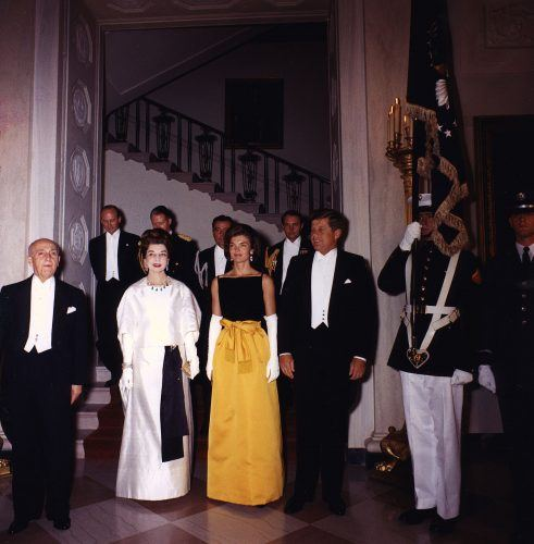 President John F. Kennedy and Jacqueline Kennedy, right, pose for a photograph with guests before a dinner in honor of the President of Peru, left, at the White House September 19, 1961 in Washington, DC