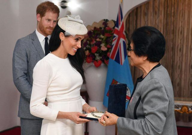 Meghan, Duchess of Sussex is presented with a pearl necklace from Sarote Faga Konrote