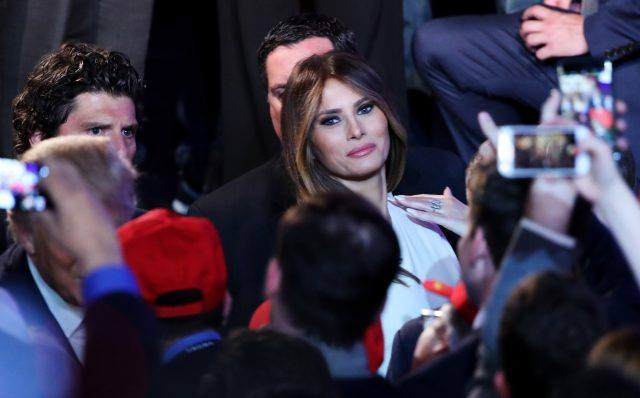 Melania Trump acknowledges people in the crowd after her husband and Republican president-elect Donald Trump delivered his acceptance speech