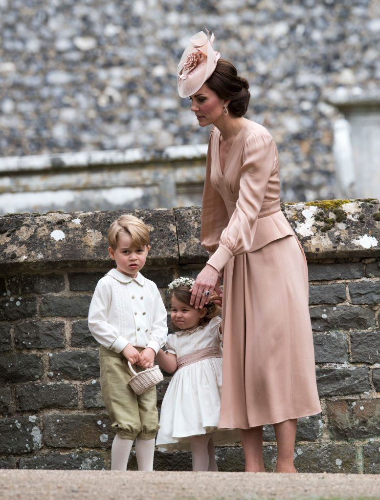 Catherine, Duchess of Cambridge, speaks to Princess Charlotte and Prince George after the wedding of Pippa Middleton.