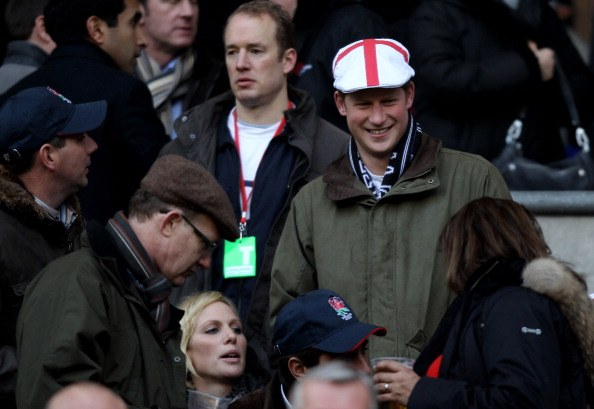 Zara Phillips and Prince Harry look on prior to the RBS 6 Nations Championship match between England and France at Twickenham Stadium on February 26, 2011