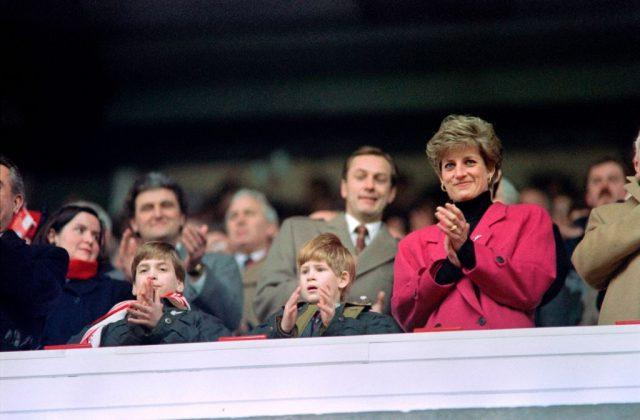 Diana, Princess of Wales, (R), Princes William (L) and Harry applaud during the Wales vs France Five Nations Cup match at Cardiff Arms Park on February 1, 1992