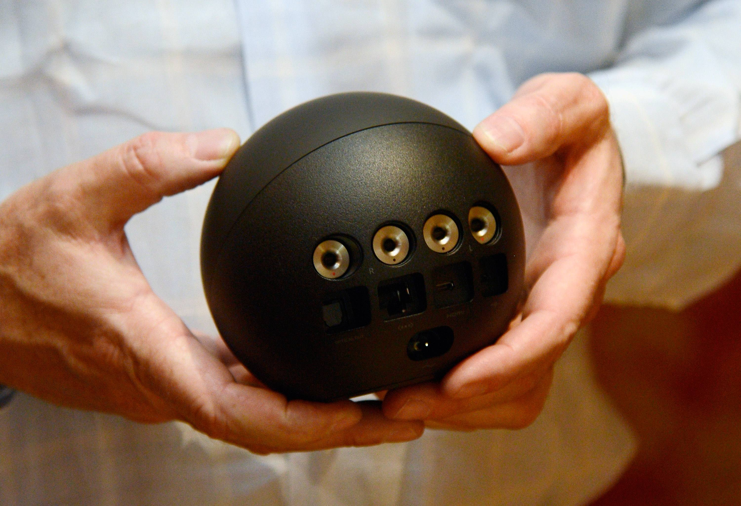 Man holding Google Nexus Q, one of the worst failed products in the tech sector