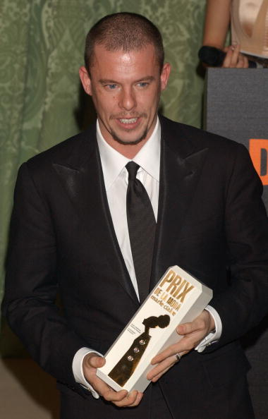 British designer Alexander McQueen receives a Marie Claire Fashion award at the 1st Edition of the Marie Claire Magazine Fashion Awards at French Embassy November 18, 2003 in Madrid, Spain