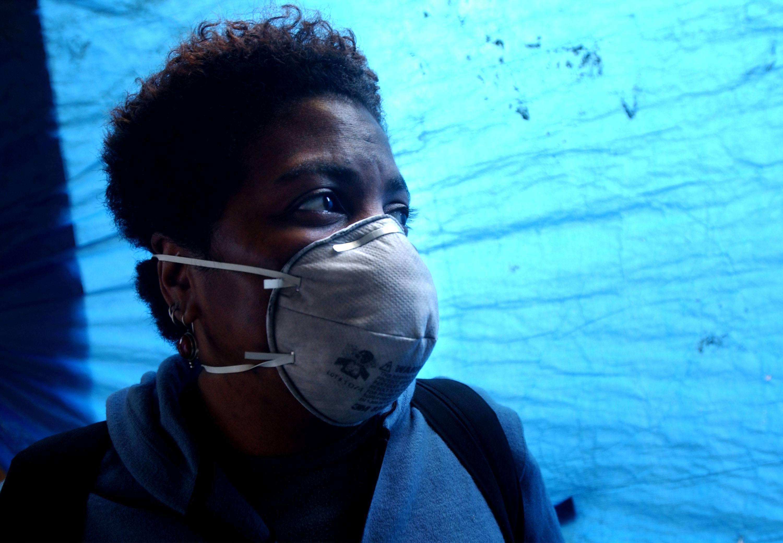 Woman in mask fears asbestos fibers in New York City