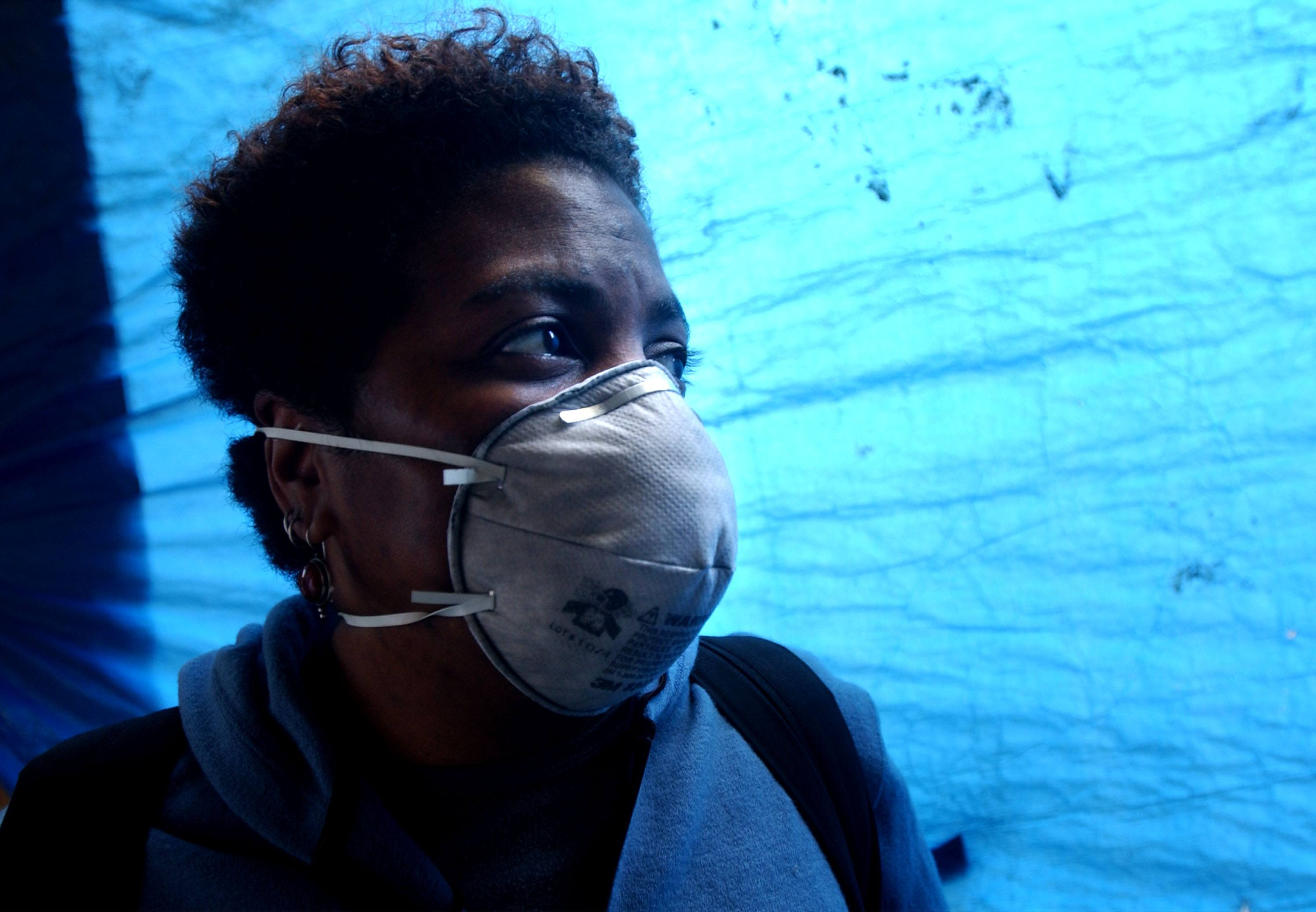 Woman in mask fears asbestos fibers in New York City