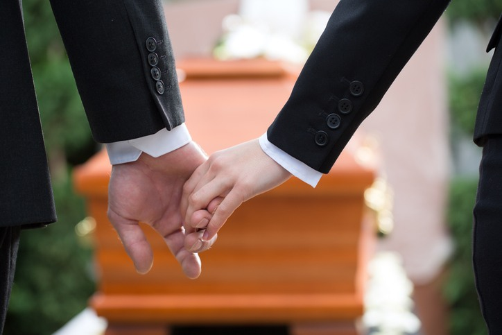 Holding hands at a funeral