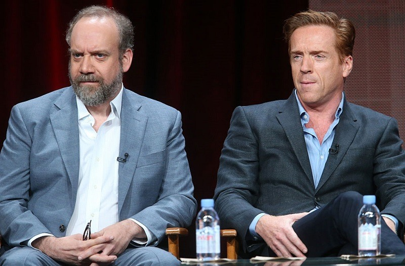 BEVERLY HILLS, CA - AUGUST 11: Actors Paul Giamatti (L) and Damian Lewis speak onstage during the 'Billions' panel discussion at the Showtime portion of the 2015 Summer TCA Tour at The Beverly Hilton Hotel on August 11, 2015 in Beverly Hills, California.