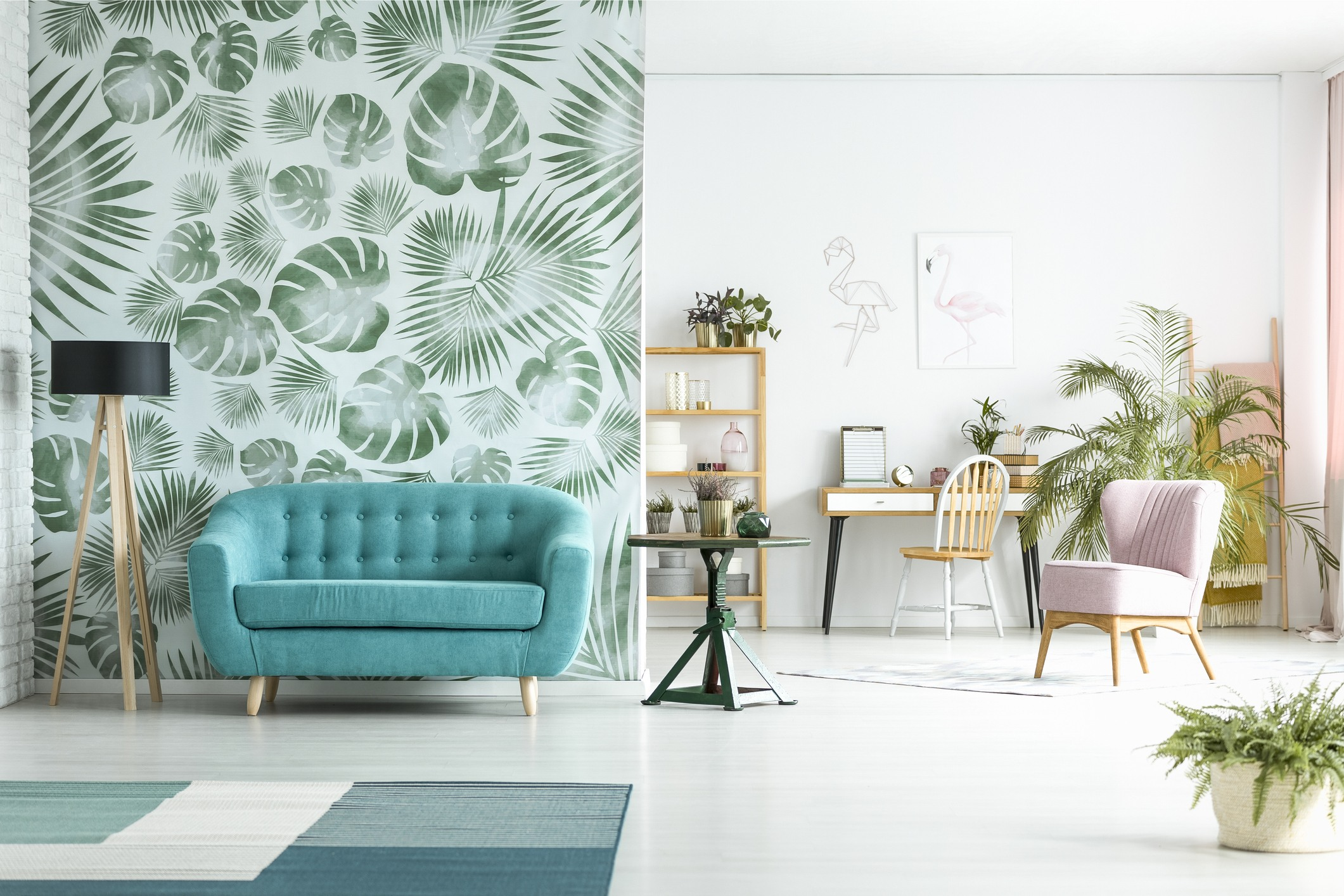 Living room with palm print wallpaper