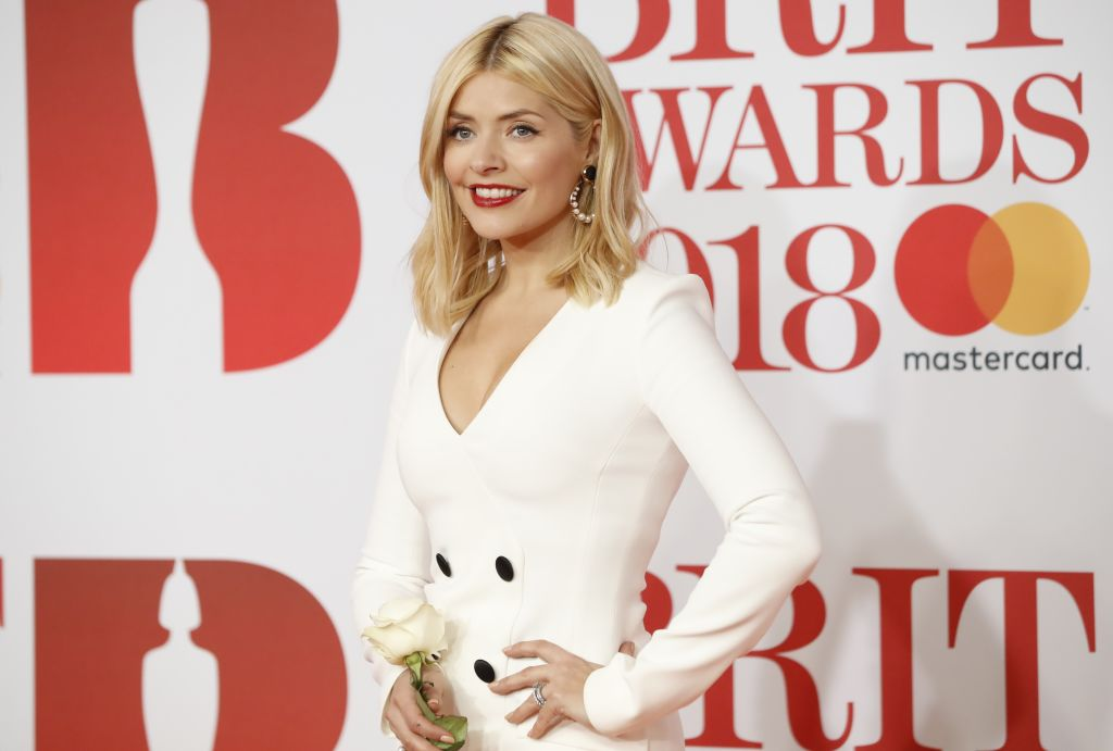 British TV host Holly Willoughby's net worth includes money from modeling work early in her career.