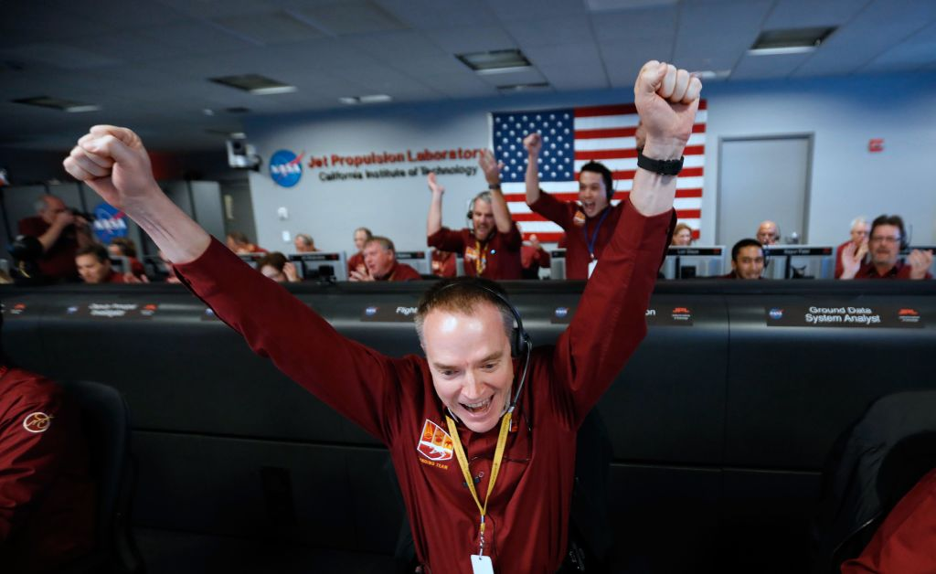 NASA engineer Kris Bruvold reacts after the successful Mars landing by the InSight spacecraft.
