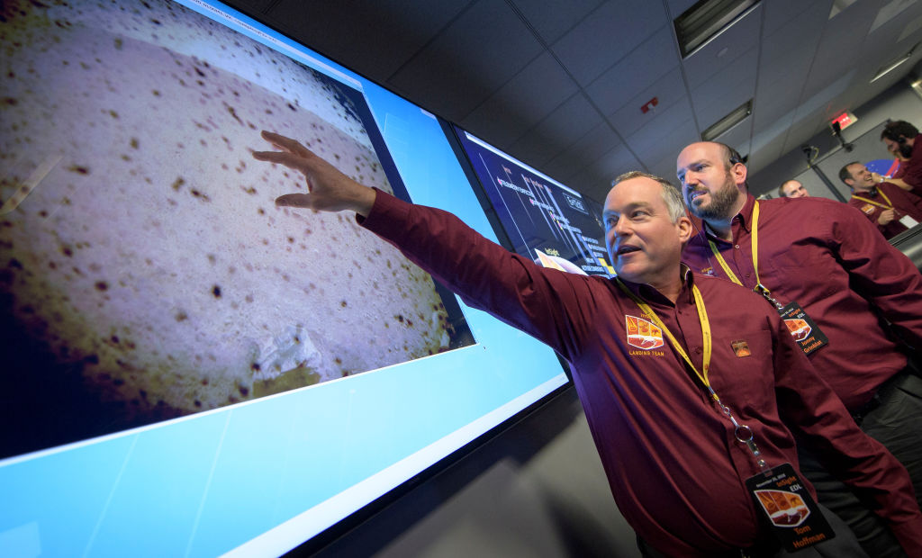Tom Hoffman, project manager of NASA's Mars InSight landing, points to the landing site.