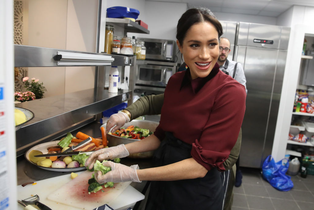 Meghan, Duchess of Sussex visits the Hubb Community Kitchen to see how funds raised by the 'Together: Our Community' Cookbook are making a difference at Al Manaar, North Kensington on November 21, 2018 in London, England