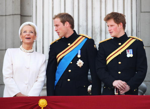 Princess Michael of Kent, Prince William and Prince Harry watch the fly past from the balcony of Buckingham Palace during the Trooping the Colou