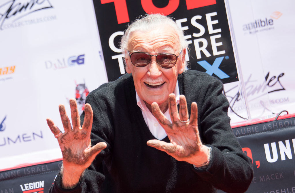 Comic-book writer, editor, and publisher Stan Lee places his hands in cement during his hand and footprint ceremony at TCL Chinese Theatre IMAX, on July 18, 2017, in Hollywood, California.