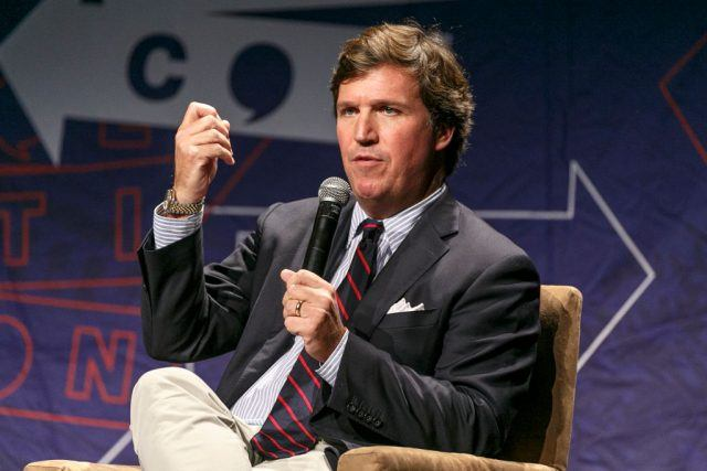 Tucker Carlson speaks onstage during Politicon 2018