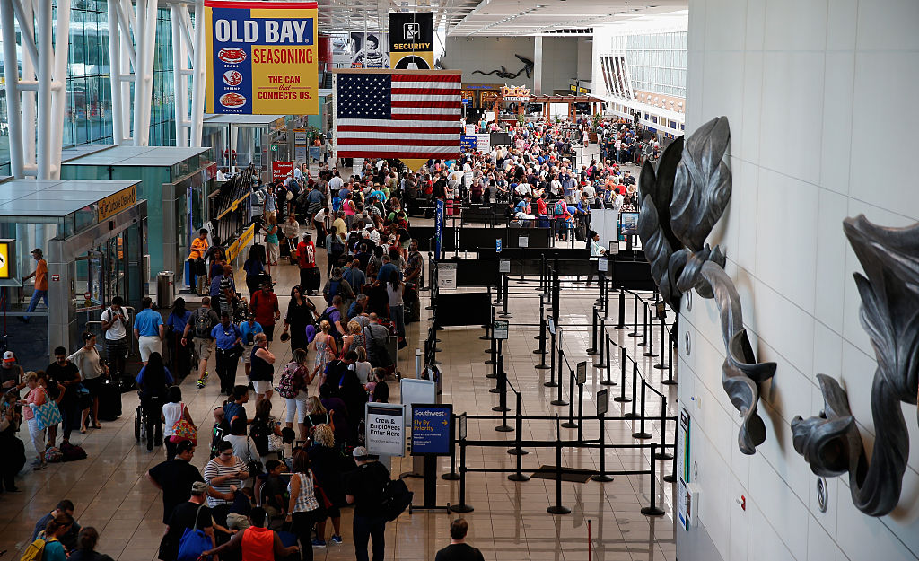 Travelers wait in line at Baltimore Washington International Airport, which is one of the worst in America.