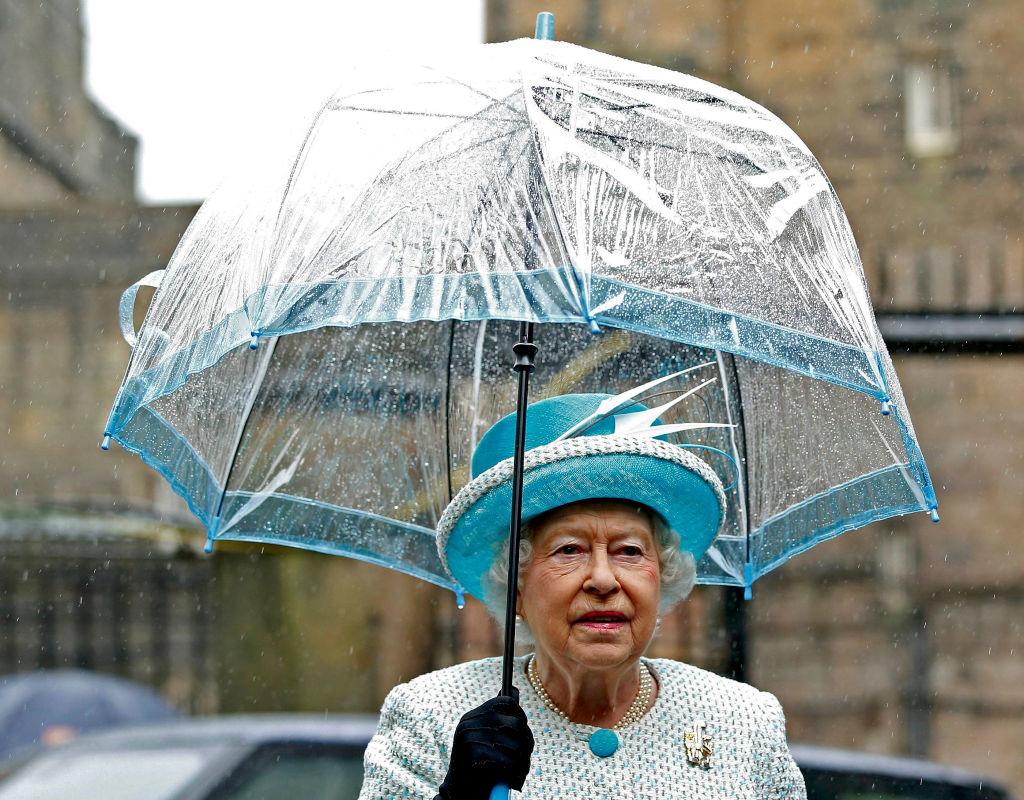 Queen Elizabeth with a blue bird cage umbrella