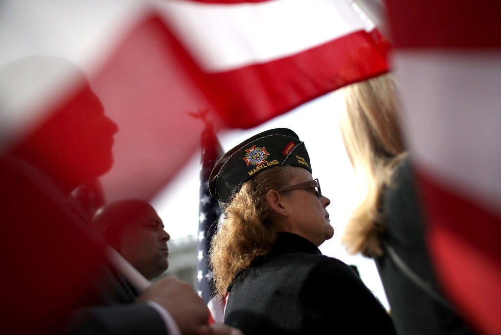 A female veteran looks on during a news conference