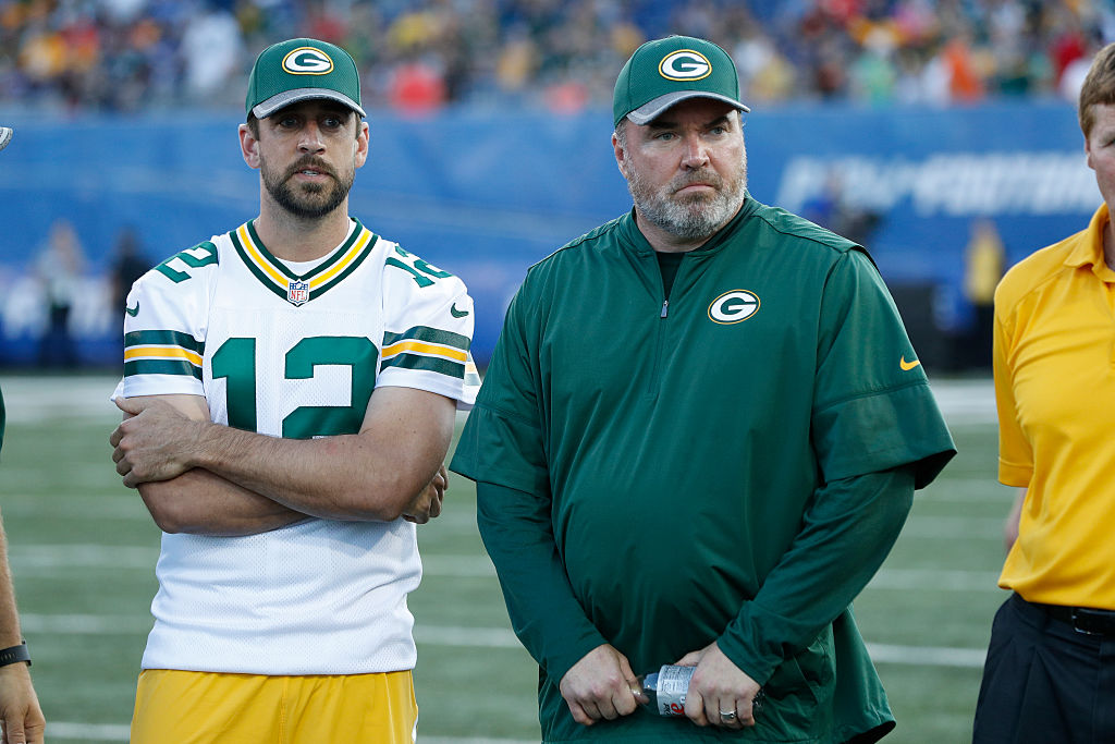 Aaron Rodgers and head coach Mike McCarthy of the Green Bay Packers look on after the NFL Hall of Fame Game against the Indianapolis Colts was cancelled due to poor field conditions at Tom Benson Hall of Fame Stadium on August 7, 2016 in Canton, Ohio.