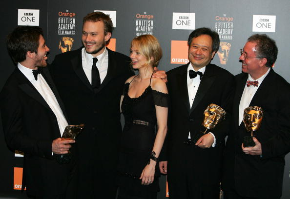 The cast and director of the film 'Brokeback Mountain' pose for photographs after winning 'Best Film' award at the British Academy of Film and Television Arts (BAFTA) awards ceremony at the Odeon Leicester Square in London, 19 February 2006. (From L-R Jake Gyllenhaal, Heath Ledger, Michelle Williams, Ang Lee and James Schamues)