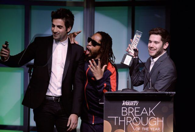 Honorees Rus Yusupov (L) and Colin Kroll (R) accept the Breakthrough Award for Emerging Technology from rapper Lil Jon