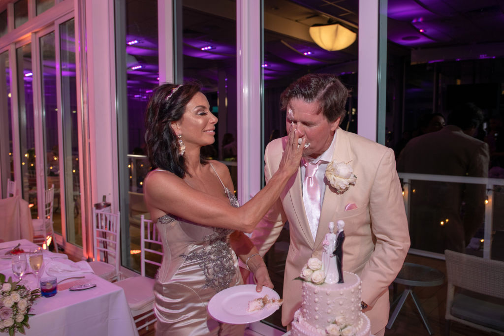 Danielle Staub and Martin Caffrey cut their wedding cake in Bimini on May 5, 2018 in Bimini, Bahamas.