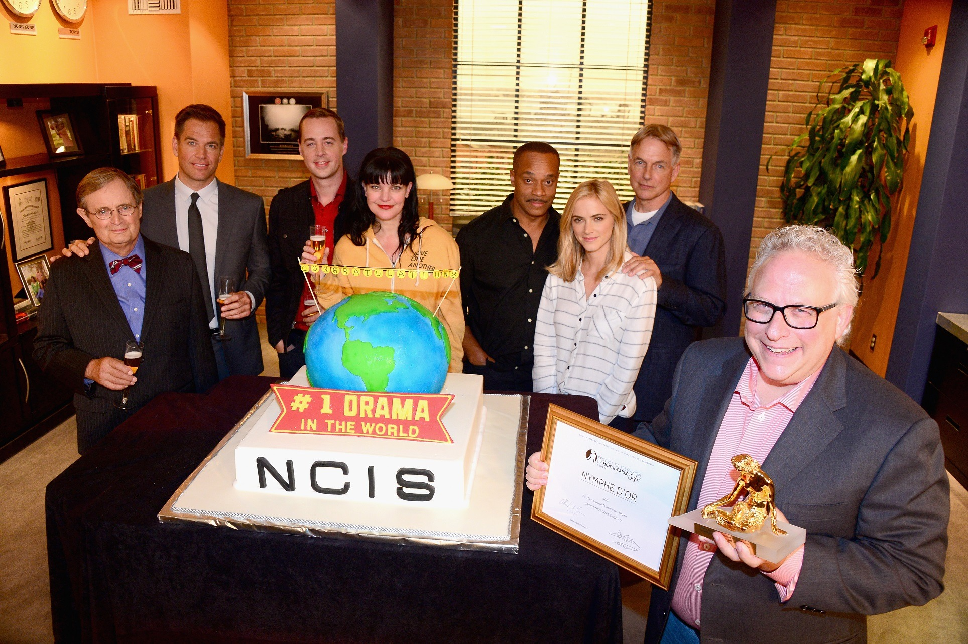 David McCallum (left), Sean Murray (second from left), and the cast of NCIS.