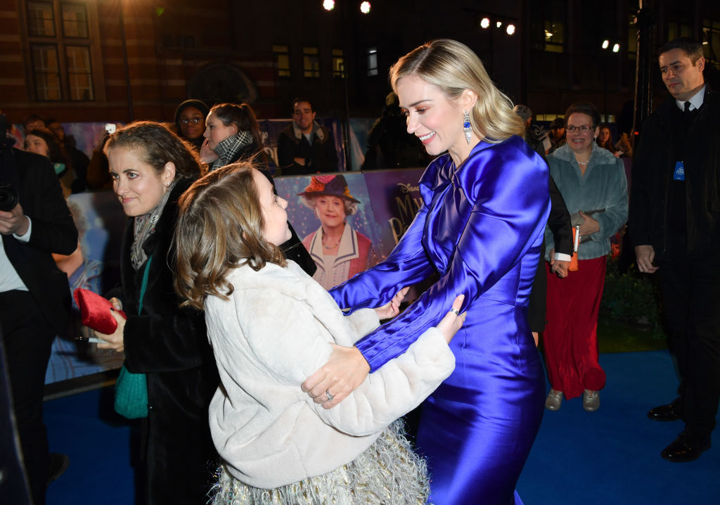 """Pixie Davies and Emily Blunt attend the European Premiere of """"Mary Poppins Returns"""" at Royal Albert Hall on December 12, 2018 in London, England."""