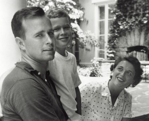 George W. Bush (C) poses with father George Bush and his mother Barbara Bush in Rye, New York, summer 1955