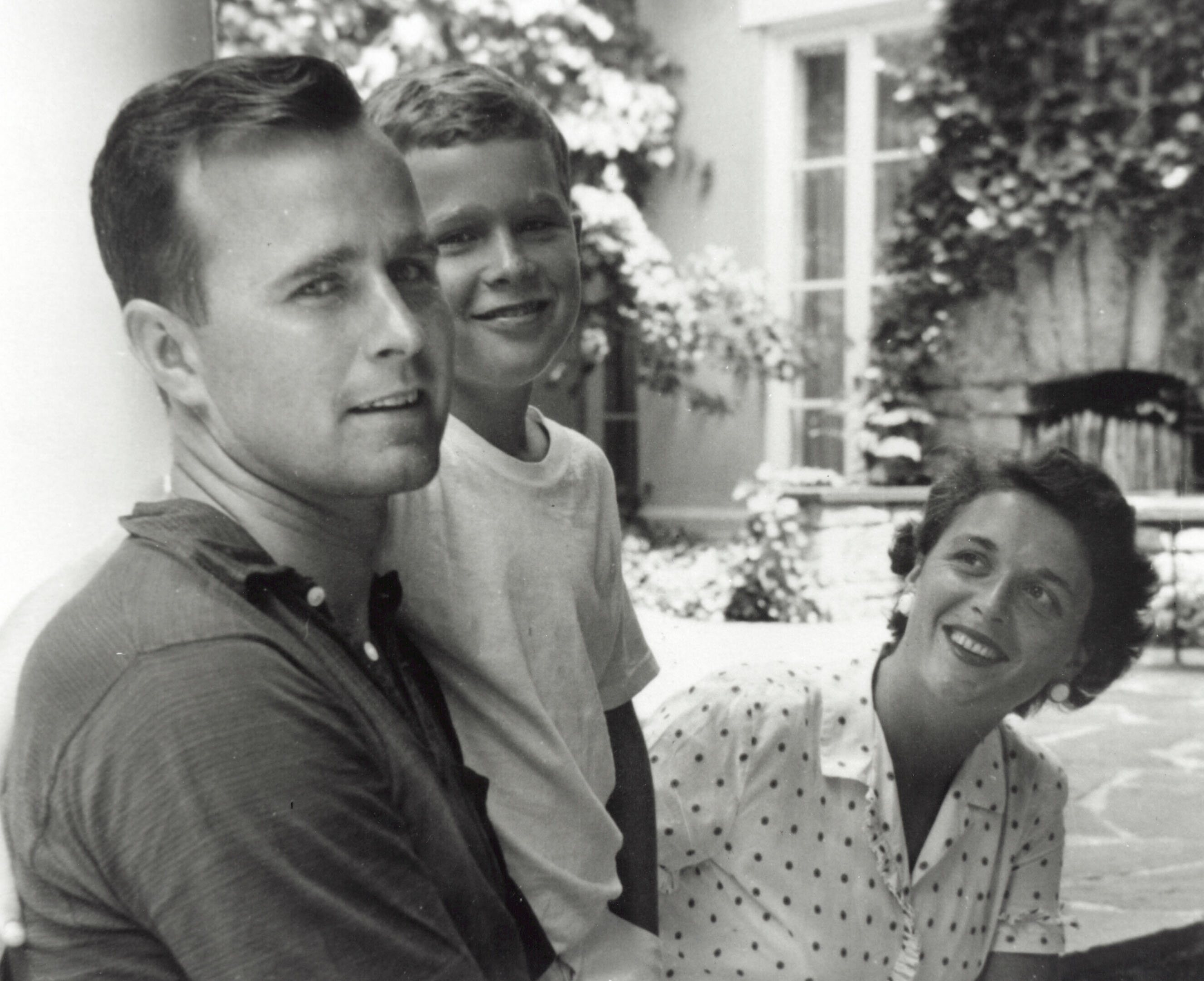George W. Bush (C) poses with father George H.W. Bush and his mother Barbara Bush in Rye, New York, summer 1955