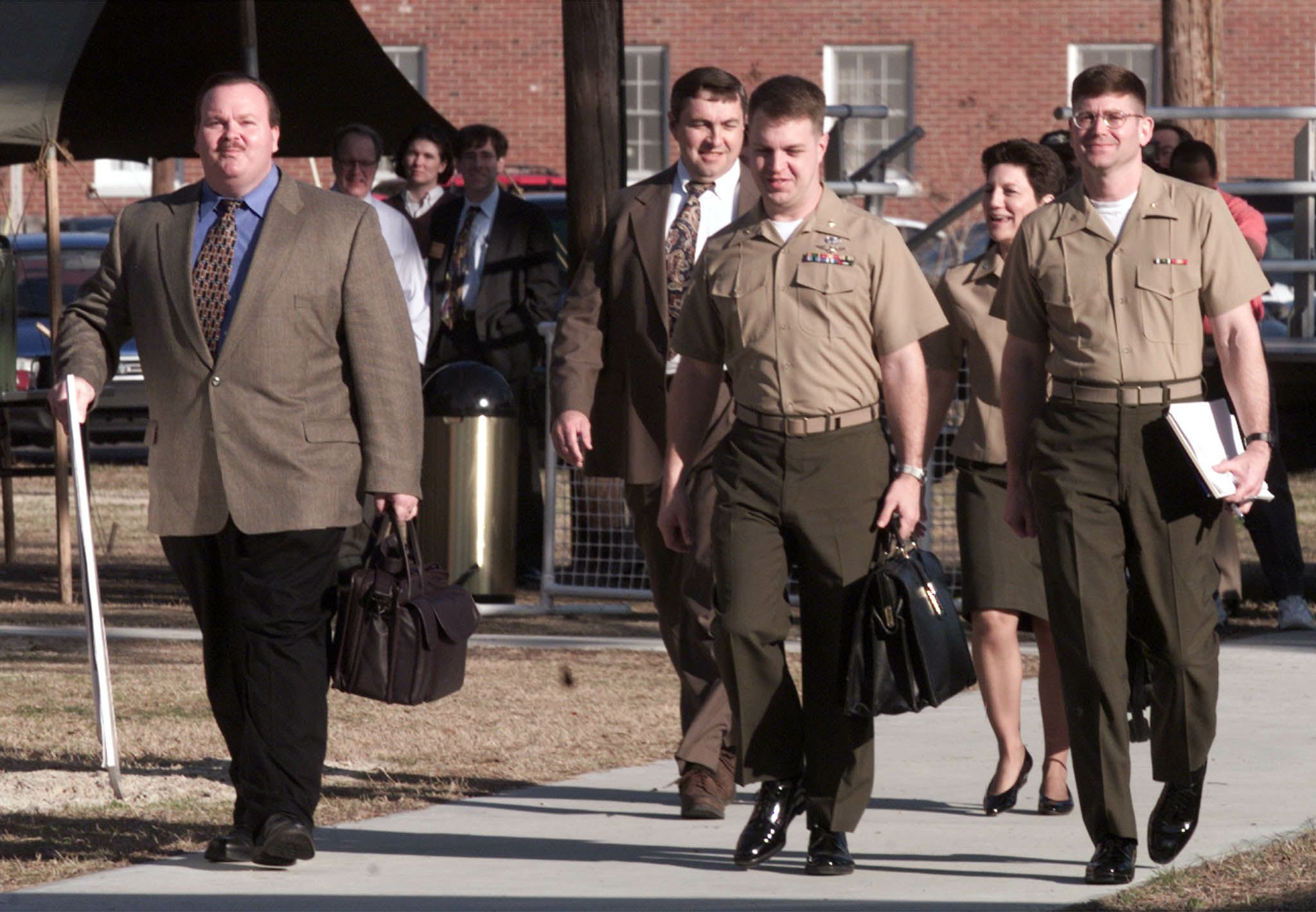Real-life NCIS agents on their way to the courtroom.