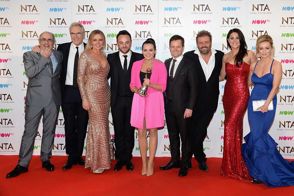 (L-R) Larry Lamb, Carol Vorderman, Anthony McPartlin, Scarlett Moffatt, Declan Donnelly, Martin Roberts, Sam Quek and Ola Jordan pose in the winners room with the award for Best Challenge Show for I'm a Celebrity... Get Me Out of Here, at the National Television Awards at The O2 Arena on January 25, 2017 in London, England.
