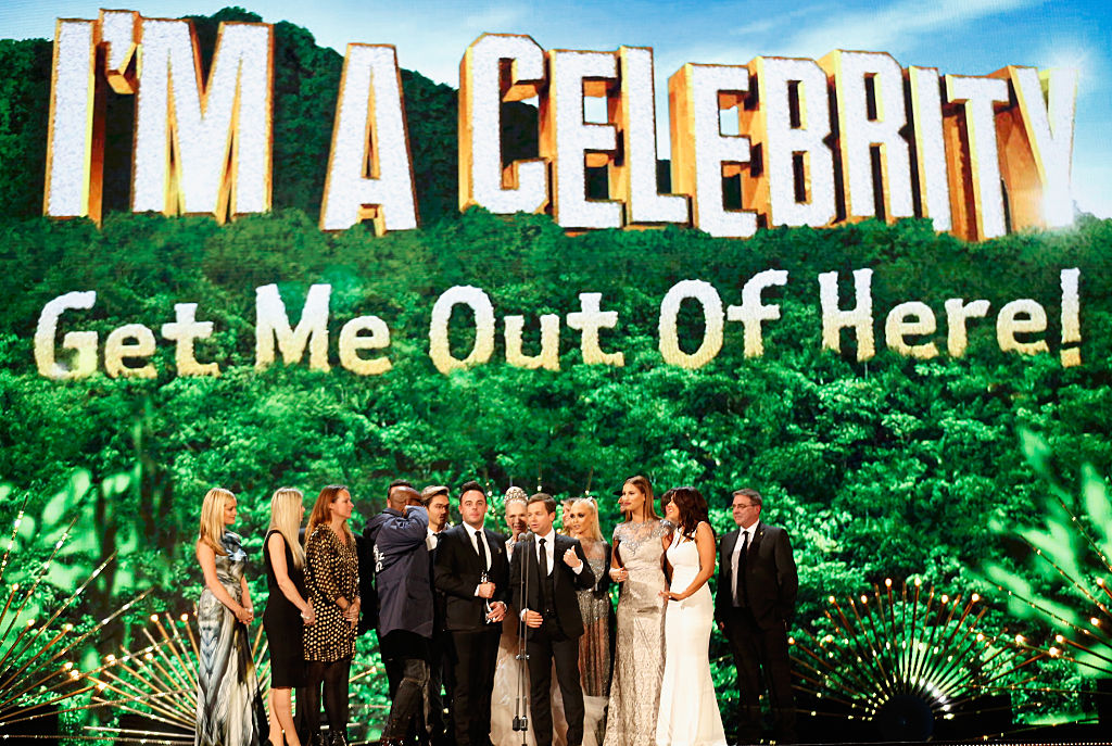 """Anthony McPartlin (L) and Declan Donnelly and the cast of """"I'm A Celebrity...Get Me Out Off Here!' win the award for Best Entertainment Program at the 21st National Television Awards at The O2 Arena on January 20, 2016 in London, England."""