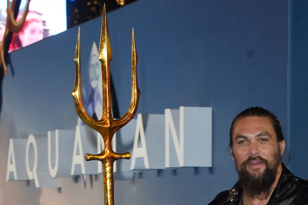 "Jason Momoa poses upon arrival to attend the World Premiere of the film ""Aquaman"" in London on November 26, 2018."