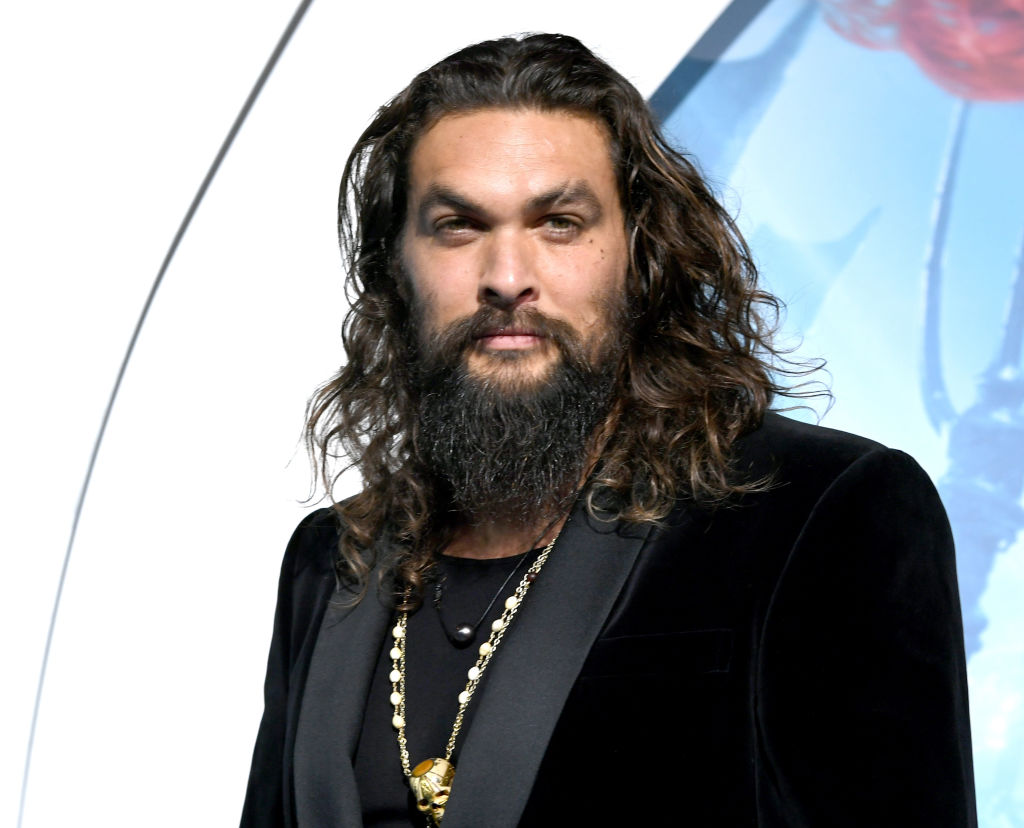 """Jason Momoa arrives at the premiere of Warner Bros. Pictures' """"Aquaman"""" at the Chinese Theatre on December 12, 2018 in Los Angeles, California."""