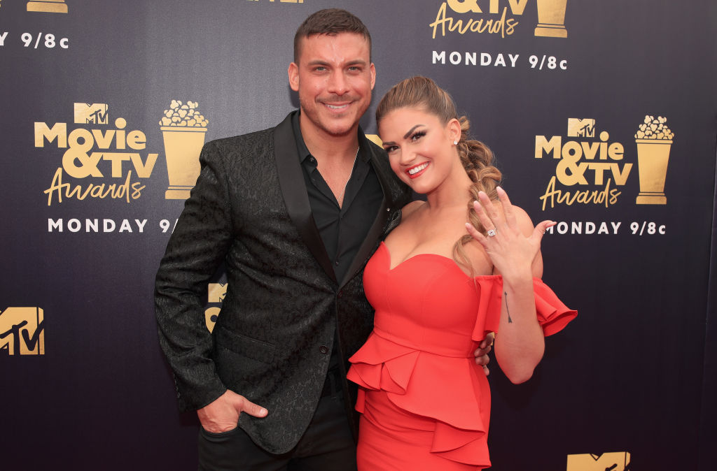 Jax Taylor (L) and Brittany Cartwright attend the 2018 MTV Movie And TV Awards at Barker Hangar on June 16, 2018 in Santa Monica, California.