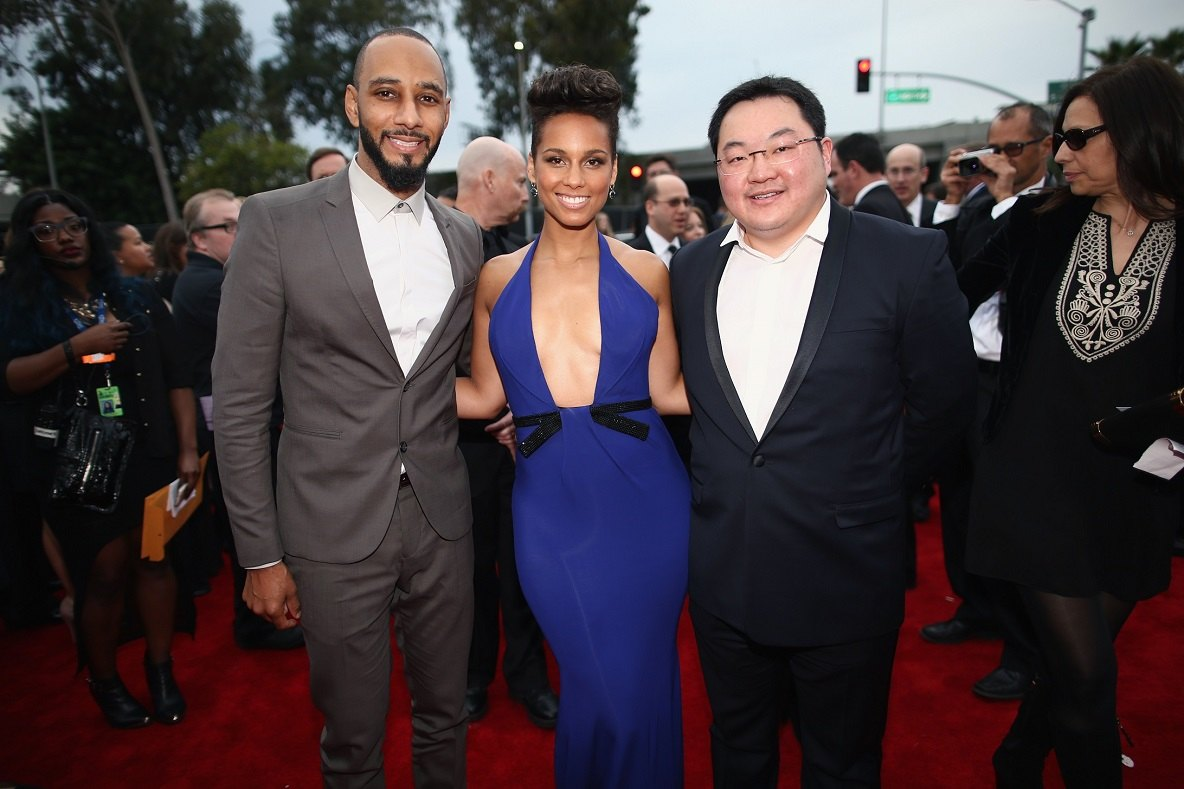 Jho Low (right) with Swizz Beats and Alicia Keys at the 2014 Grammy Awards.