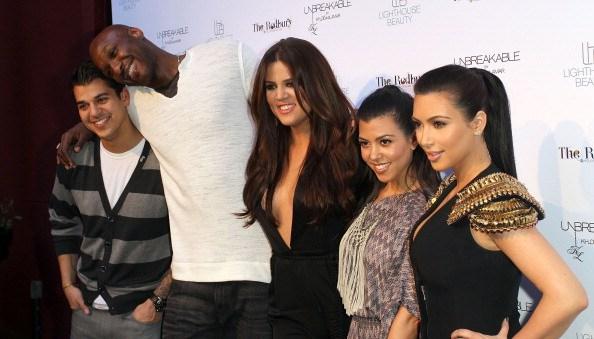 Rob Kardashian, Lamar Odom, Khloe Kardashian Odom, Kourtney Kardashian, and Kim Kardashian pose