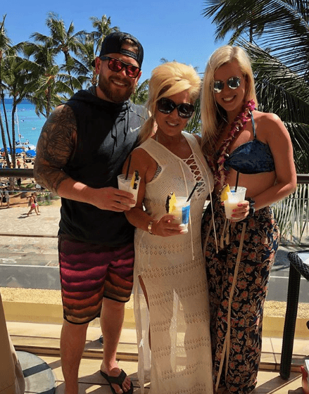 Larry Jr. Caputo with Theresa Caputo and his girlfriend